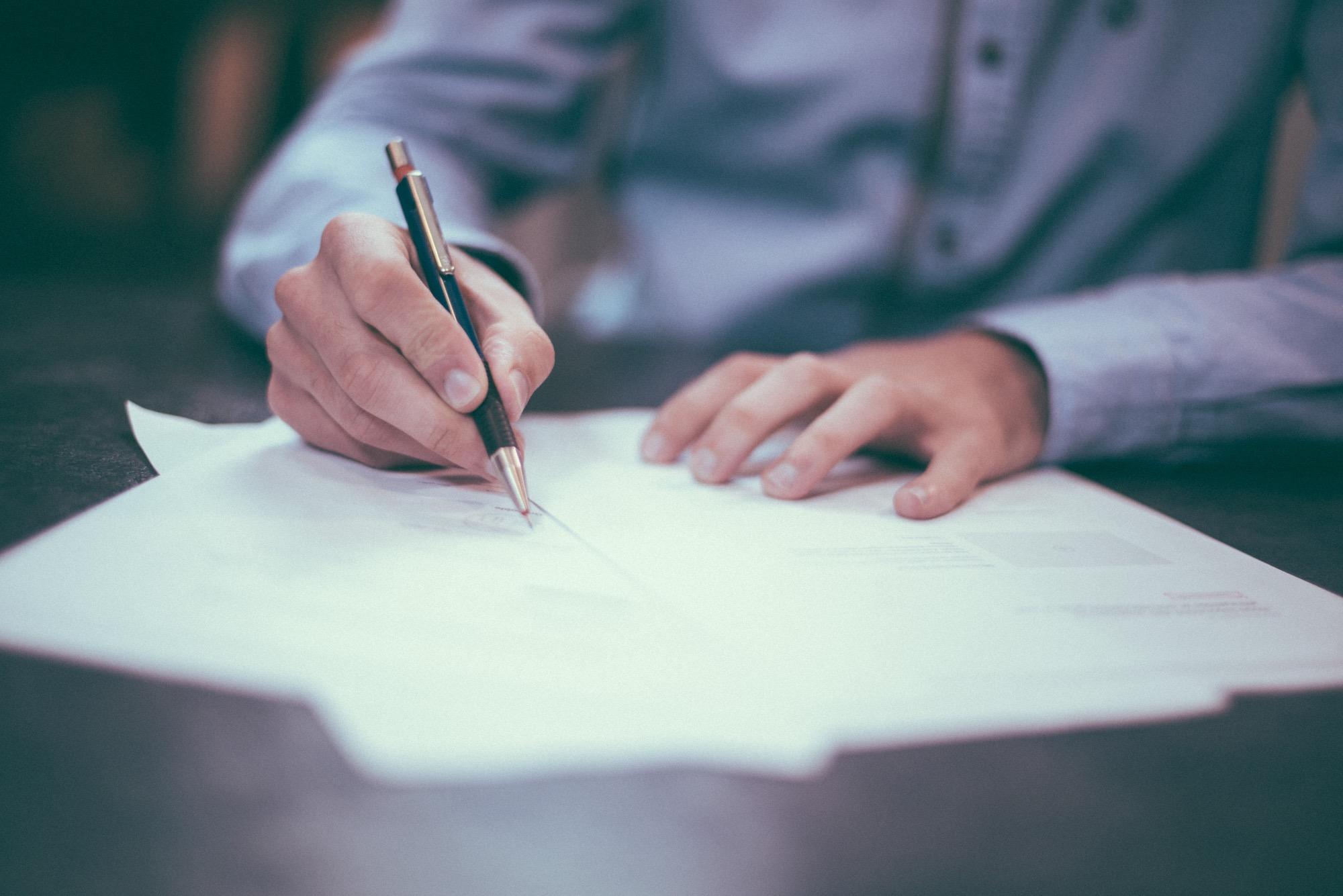 Man signing a loan